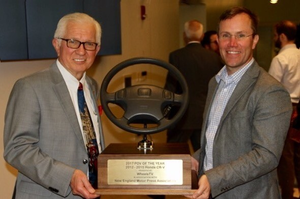 WheelsTV CEO Jim Barisano on the left helps Chris Naughton of Honda and Acura heft the largest (and heaviest) North American auto industry award at the 2017 Annual NEMPA Awards Night.