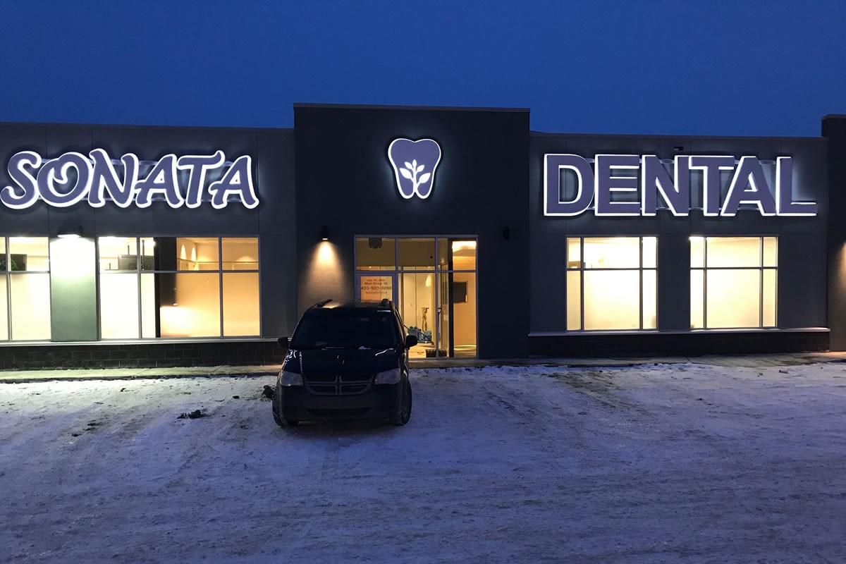 Night view of Sonata Dental Airdrie Alberta T4B3G4